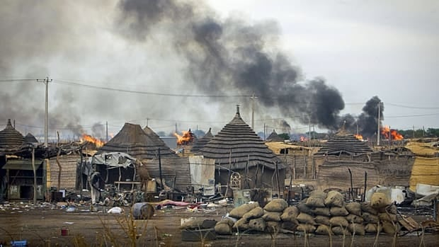 In a photo provided by the United Nations Mission in Sudan, homesteads burn in the centre of Abyei town, Sudan, on May 28, 2011. Tens of thousands have fled the contested north-south border region of Abyei and a UN report warns of the danger of 'ethnic cleansing.'