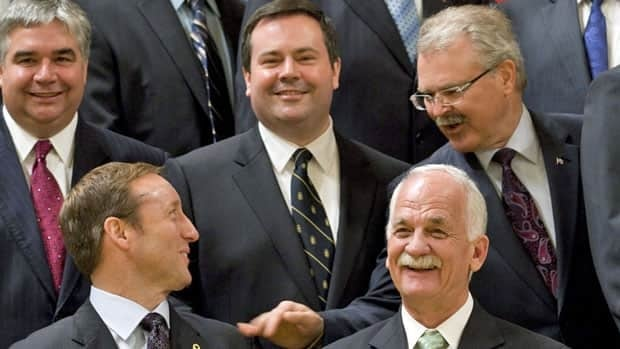 Agriculture Minister Gerry Ritz, top right, who oversees the Canadian Wheat Board, jokes with National Defence Minister Peter MacKay, bottom left, as Leader of the Government in the House of Commons Peter van Loan, left, Citizenship and Immigration Minister Jason Kenney and Public Safety Minister Vic Toews pose for a photo after being sworn in during a ceremony at Rideau Hall in Ottawa on May 18. These ministers are behind much of the legislation that made it through the House of Commons this fall.
