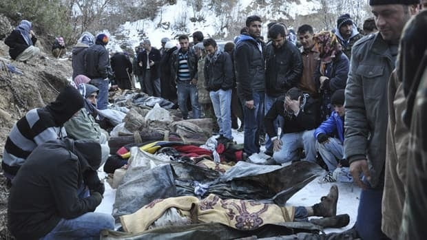 Villagers in southeastern Turkey gather around the bodies of people killed by an airstrike late Wednesday night.