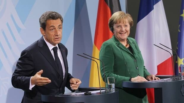 A meeting between French President Nicolas Sarkozy, left, and German Chancellor Angela Merkel over the weekend ended with optimism that a solution to Europe's debt crisis can be found.