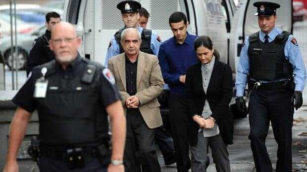 Mohammad Shafia, centre, Tooba Mohammad Yahya and their son, Hamid Mohammad Shafia, centre back, arrive at the Kingston, Ont., courthouse at the start of their first-degree murder trial.