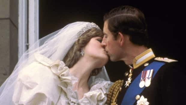 Prince Charles kisses his bride, Diana, Princess of Wales, on the balcony of Buckingham Palace in London, after their wedding on July 29, 1981.