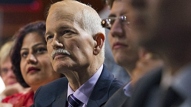 NDP Leader Jack Layton listens to speeches during the party's 50th anniversary convention in Vancouver on Saturday.