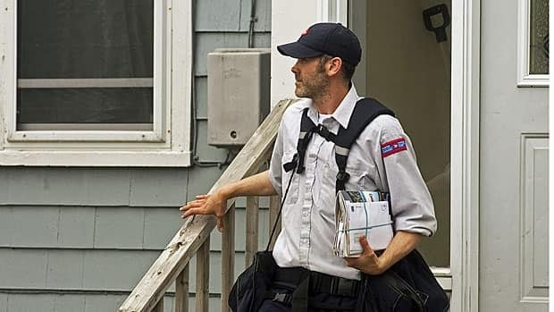 A letter carrier delivers mail in Halifax on May 30, 2011.