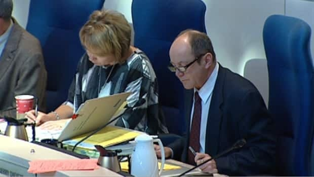 Councillors Linda Sloan and Kerry Diotte look over documents during Monday's budget debate at Edmonton city hall.