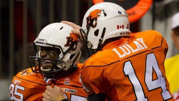 B.C. Lions' Shawn Gore, left, and Travis Lulay celebrate Gore's touchdown against the Montreal Alouettes during the first half of the Lions' 43-1 romping of the Als in their final regular season game.