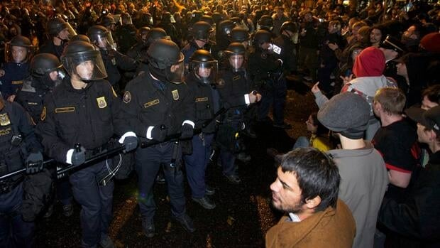 Police in riot gear stand off with Occupy Wall Street protesters in Portland, Ore., on Nov. 13, 2011. Some officers used nightsticks to push people away from the encampment and warned that anyone who resisted risked arrest.
