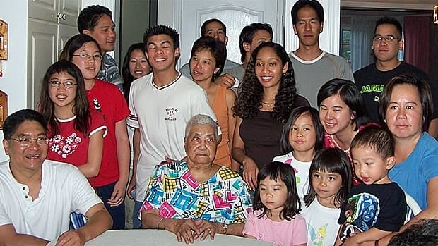 Violet Ho Sue, centre, has dementia and has been in and out of palliative care.  She is pictured here with her extended family on her 92nd birthday.
