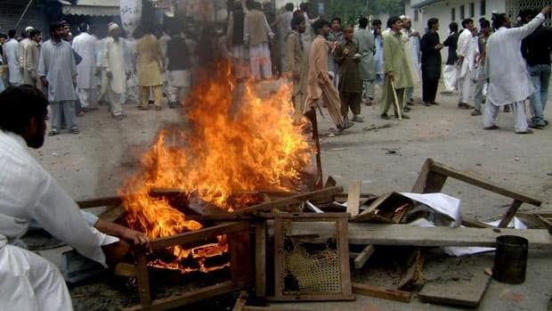 Pakistani protesters burn furniture on April 12 during a riot in Abbottabad, the city north of Islamabad where Osama bin laden was reportedly killed Sunday.  The protesters in this picture were angry that their Northwest Frontier Province was to be renamed Khyber-Pakhtoonkhwa. Police said they fired tear gas and bullets into the crowd after they attacked police stations and burned vehicles, killing seven people.