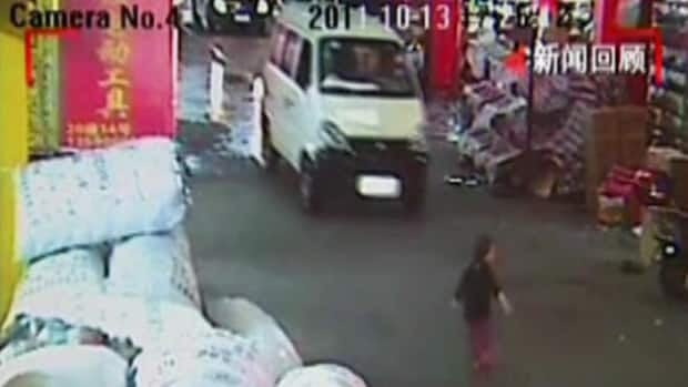 This image from video shows a girl just before she was hit by a van in a market in the Chinese city of Foshan on Oct. 13.