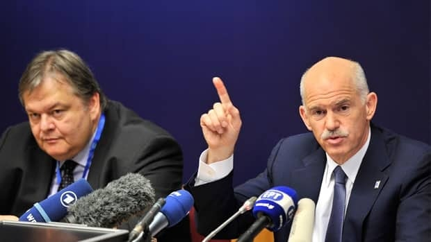 Greek Prime Minister George Papandreou, right, has announced that he will put the European Union's austerity measures for its latest bailout package to a public vote in Greece.