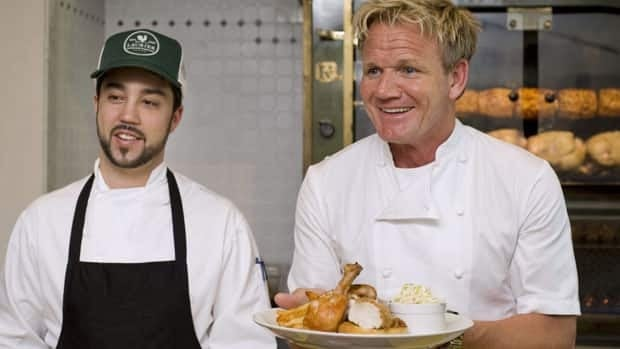 Chef Gordon Ramsay, right, passes out some food during a cooking demonstration at his new restaurant, Laurier Gordon Ramsay, in Montreal on Tuesday as head chef Guillermo Russo looks on. The posh eatery's opening night Wednesday was cut short when the sprinkler system somehow went off.