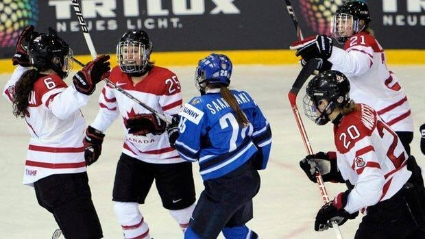 Canada's Rebecca Johnston (6) Tessa Bonhomme (29) , Haley Irwin (20) and Jennifer Wakefield (21) celebrate a goal against Finland at the Four Nations Cup tournament Tuesday in Winterthur, Switzerland.