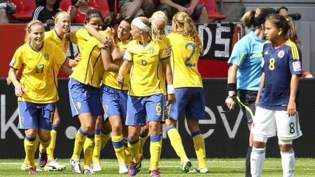 Swedish players celebrate scoring against Colombia during Tuesday's match.