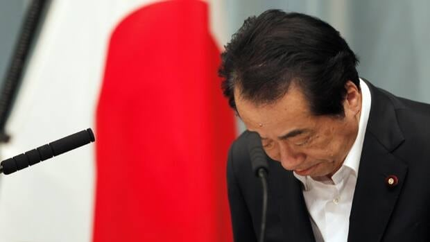 Japanese Prime Minister Naoto Kan bows at the start of a news conference at his official residence in Tokyo on Wednesday. Kan said Japan needs to increase the independence of nuclear regulators to ensure safety in the wake of the country's nuclear accident.