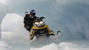 Snowmobiler riding in snow