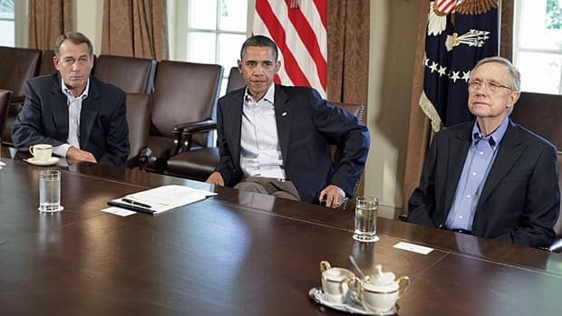 U.S. President Barack Obama sits with House Speaker John Boehner (left), a Republican, and Senate Majority Leader Harry Reid, a Democrat, during a meeting about the debt limit at the White House on Saturday. No agreement was reached as negotiations continued Sunday.