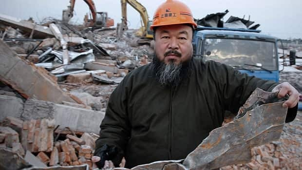 Chinese artist and activist Ai Weiwei, seen outside his demolished Shanghai art studio in January, was detained by Beijing authorities on Sunday.