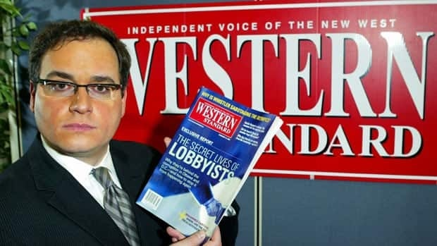 Ezra Levant holds up a copy of Western Standard magazine containing the controversial Prophet Mohammed cartoons in the magazine's downtown offices in Calgary in 2006.  Levant's account about his ordeal with human rights commissions over publishing the cartoons has been picked as Canada's best political book.