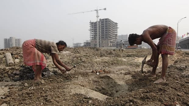 Labourers work at the site of a residential estate under construction in Calcutta, India. The country's population has grown 17.6 per cent in the past decade.