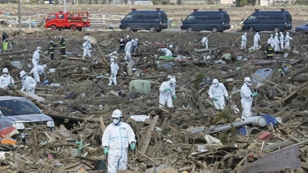 Police officers wearing protective suits search for victims in Minamisoma City, Fukushima prefecture, on March 28.