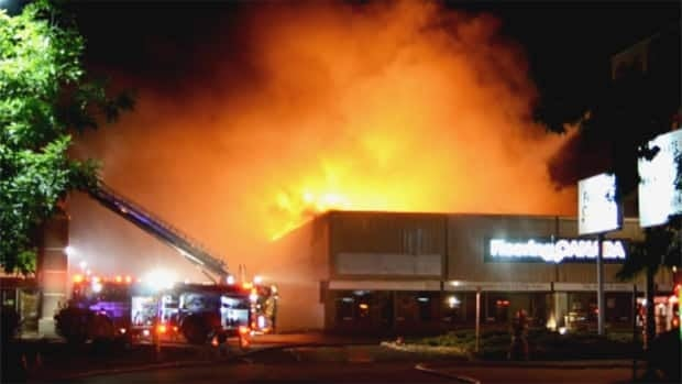 Firefighters in Kelowna battle a blaze at a strip mall on Banks Road Saturday morning. Three suspicious blazes were set at the backs of three buildings overnight.