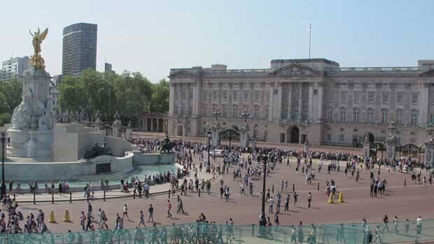 Tourists fill the mall in front of Buckingham Palace on Monday, just four days before the royal wedding.