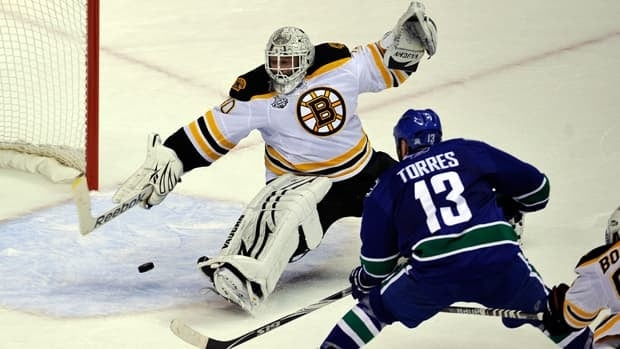 Raffi Torres (13) of the Vancouver Canucks scores a goal late in the third period against Tim Thomas (30) of the Boston Bruins during Game 1 at Rogers Arena on Wednesday in Vancouver.