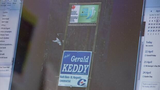 The NDP took this shot of the two signs on a busy road in Bridgewater. (CBC)