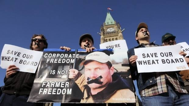 Supporters of the Canadian Wheat Board rally on Parliament Hill on Tuesday. The Canadian Wheat Board Alliance brought two dozen Western farmers to Ottawa to meet with as many Senators as possible as legislation to dismantle the board's grain marketing monopoly moves towards passage.