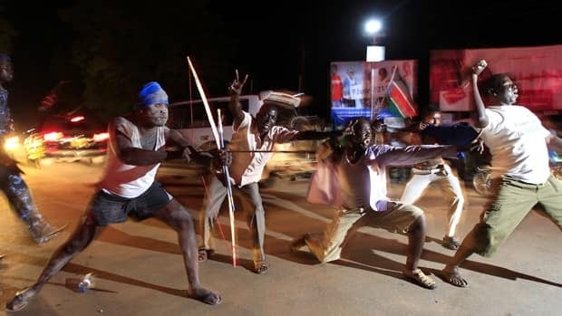 People celebrate during South Sudan's independence day celebrations along the streets of Juba early Saturday.