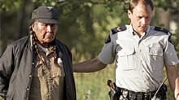John Ignace, a protester also known as Wolverine, is led from a helicopter by an RCMP officer on Sept. 17, 1995, after the armed standoff at Gustafsen Lake ended.