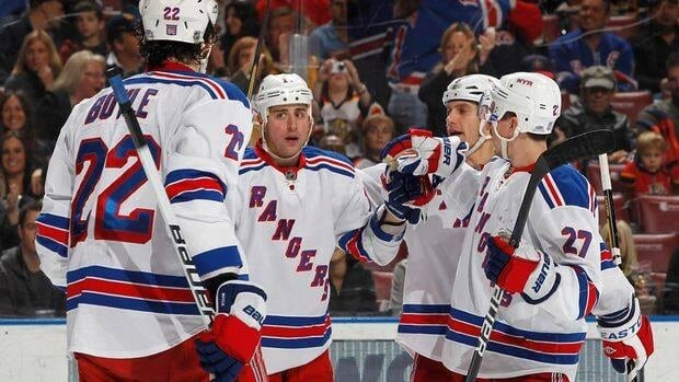 Brandon Dubinsky (17) of the New York Rangers is congratulated by teammates after scoring in the second period Friday against the Florida Panthers.