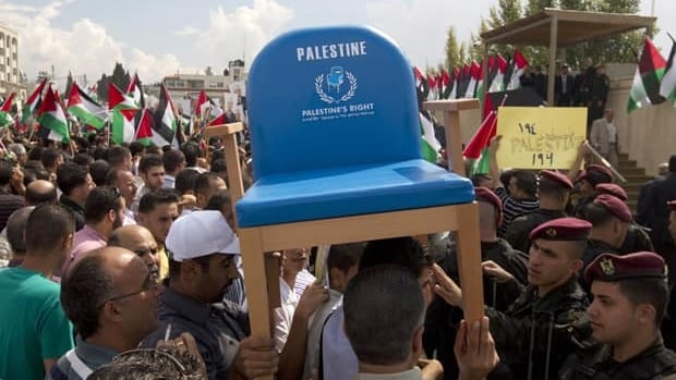 The UN Security Council is considering a bid by the Palestinian Authority for full UN membership. Palestinians carry a chair representing their application during a rally Sept. 25 in the West Bank city of Ramallah, upon President Mahmoud Abbas' return from New York.