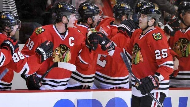 (Left to right) Chicago Blackhawks right winger Patrick Kane, centre Jonathan Toews and the rest of the team congratulate left winger Viktor Stalberg after his second goal Monday.