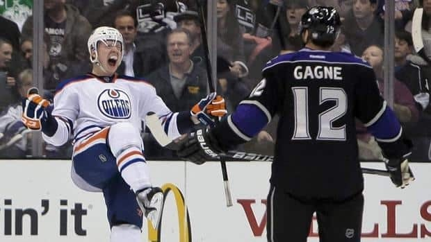 Edmonton Oilers centre Lennart Petrell, left, celebrates his goal against Simon Gagne and the Los Angeles Kings on Thursday night.