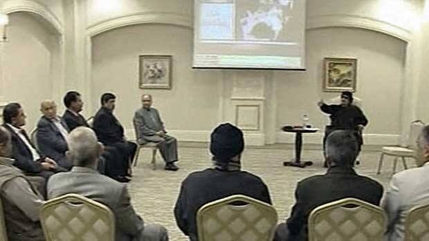 In this image made from Libyan TV, dictator Moammar Gadhafi, back right, holds a meeting with tribal leaders in Tripoli Wednesday. It was his first appearance since the death of his son in an earlier attack.