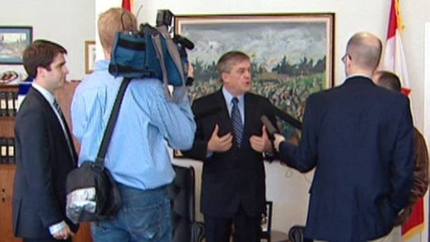 Premier David Alward speaks with reporters on Tuesday about his plans to roll back MLA pensions.