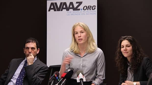 Kathleen Trotter, centre, and the online activist group Avaaz.org is suing Auditor General Sheila Fraser to release her final report into G8 spending. Emma Ruby-Sachs, right, the group's campaign director, and legal counsel Frank Addario joined Trotter at a Toronto press conference Tuesday.