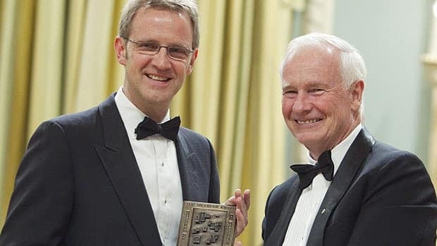Gov. Gen. David Johnston, right, presents Jim Williamson, executive producer of CBC's The Fifth Estate, with the Michener Award for meritorious public service in journalism June 14, 2011, in Ottawa. The program won for its work on the case of Ashley Smith, who killed herself in an Ontario corrections facility.