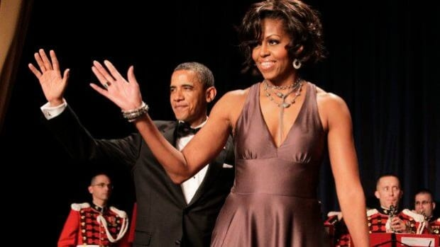 U.S. President Barack Obama and first lady Michelle Obama wave as they arrive for the White House Correspondents' Association Dinner in Washington on Saturday.
