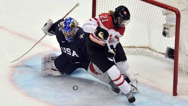 USA's goalkeeper Jessie Vetter (31) is seen stopping a shot at the 2010 Vancouver Olympics. Vetter faced 35 shots and stopped Canada in the shootout to win the Four Nations Cup on Sunday.
