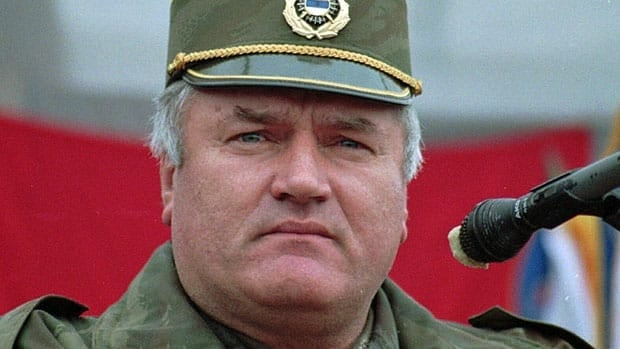 In this Dec. 2, 1995, photo, Bosnian Serb army commander Gen. Ratko Mladic addresses his troops in the eastern Bosnian town of Vlasenica.