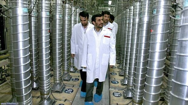 In this April 8, 2008, photo released by the Iranian President's Office, President Mahmoud Ahmadinejad visits the Natanz Uranium Enrichment Facility 322 kilometers south of the capital, Tehran. The UN nuclear atomic energy agency said Nov. 8, 2011, for the first time that Iran is suspected of conducting secret experiments whose sole purpose is the development of nuclear arms.