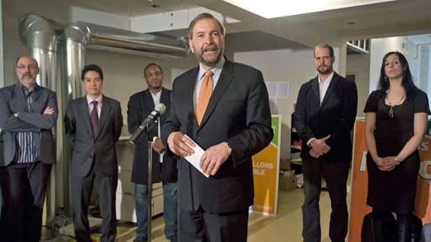 NDP deputy leader Thomas Mulcair speaks to reporters during a post-election news conference in Montreal on Tuesday. Mulcair says he doesn't believe photos exist of Osama bin Laden's body.