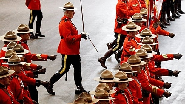 RCMP officers take up positions to form an honour guard during a change of command ceremony in Vancouver. A new agreement-in-principle would see the RCMP stay on as the main police force in B.C. and several other provinces and territories.