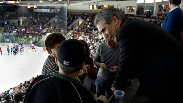 Liberal Leader Michael Ignatieff meets with fans at a OHL playoff hockey game between the Mississauga St. Michael's Majors and the Niagara IceDogs on Saturday.