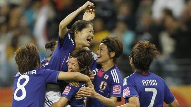 Japan's Homare Sawa, top, celebrates with teammates after scoring against Sweden on Wednesday.