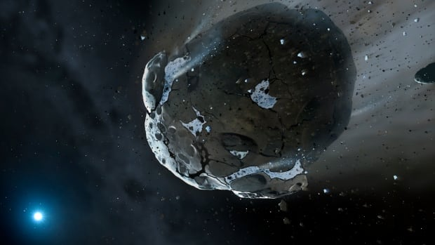 The rocky and water-rich asteroid or planet was torn apart by the strong gravity of the white dwarf star GD 61, as shown in this artist's impression. Similar objects in the solar system likely delivered the bulk of water on Earth and represent the building blocks of the terrestrial planets.