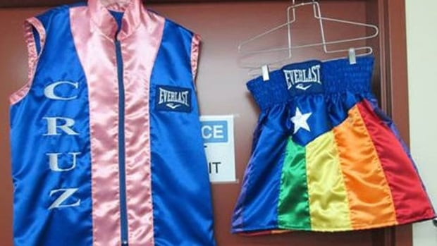 Featherweight contender Orlando Cruz will wear a pink-trimmed ring jacket, left, in support of Breast Cancer Awareness Month for his world title fight on Saturday against Orlando Salido in Las Vegas. He will also wear rainbow-coloured trunks to support the lesbian, gay, bisexual and transgender (LGBT) social movements.